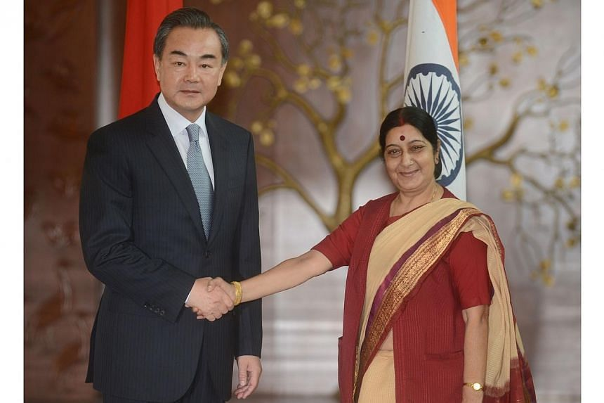 Visiting Chinese Foreign Affairs Minister Wang Yi (left) shakes hands with Indian Minister for External Affairs Sushma Swaraj during a meeting in New Delhi on June 8, 2014.India hailed talks with China on Sunday as a good step towards stronger