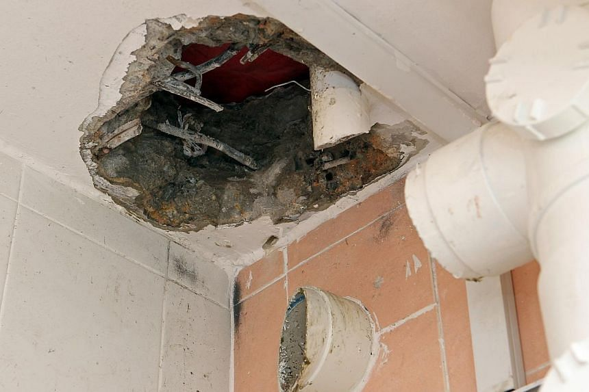 An emergency medical team was called in by the SCDF to help extricate the hand of a man that got stuck in a toilet drainage pipe for about 12 hours on Sunday, 8 June 2014. -- ST PHOTO: SEAH KWANG PENG