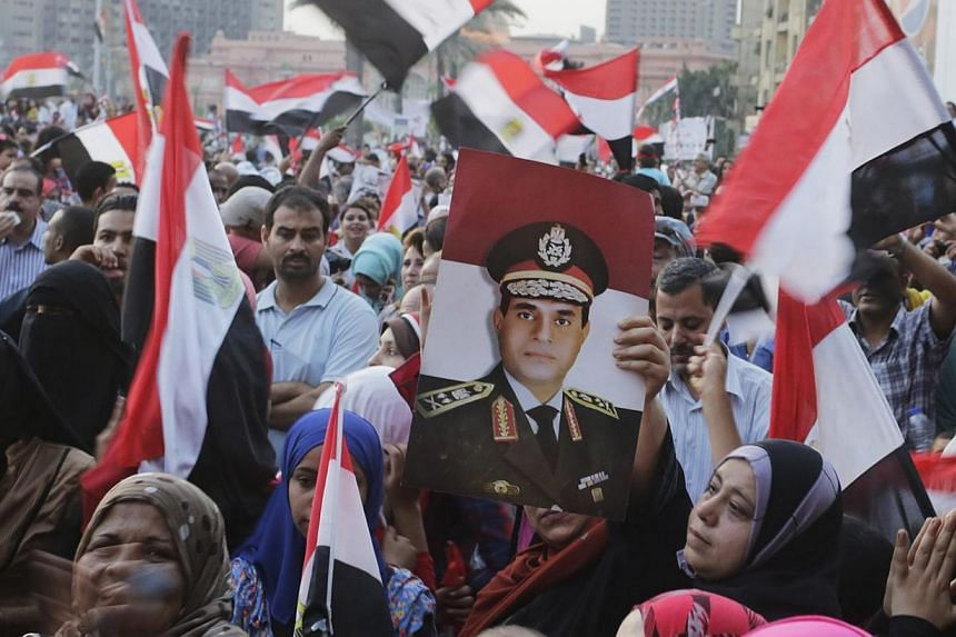 Egyptians chant slogans in Tahrir square as they arrive to celebrate former Egyptian army chief Abdel Fattah al-Sisi's victory in the presidential vote in Cairo, June 3, 2014. -- PHOTO: REUTERS