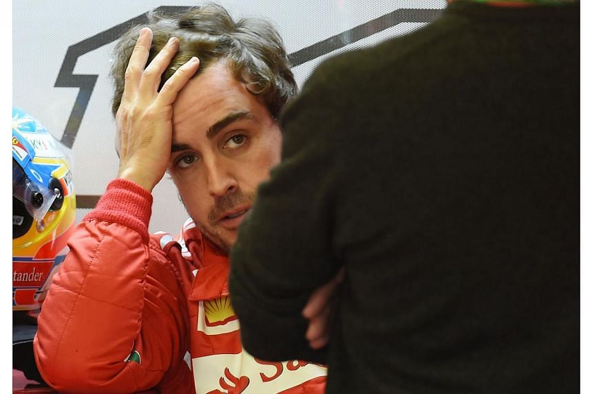 Ferrari driver Fernando Alonso of Spain in the pits at the Circuit Gilles Villeneuve in Montreal on June 6, 2014 during the first practice session for the Canadian Formula One Grand Prix. -- PHOTO: AFP