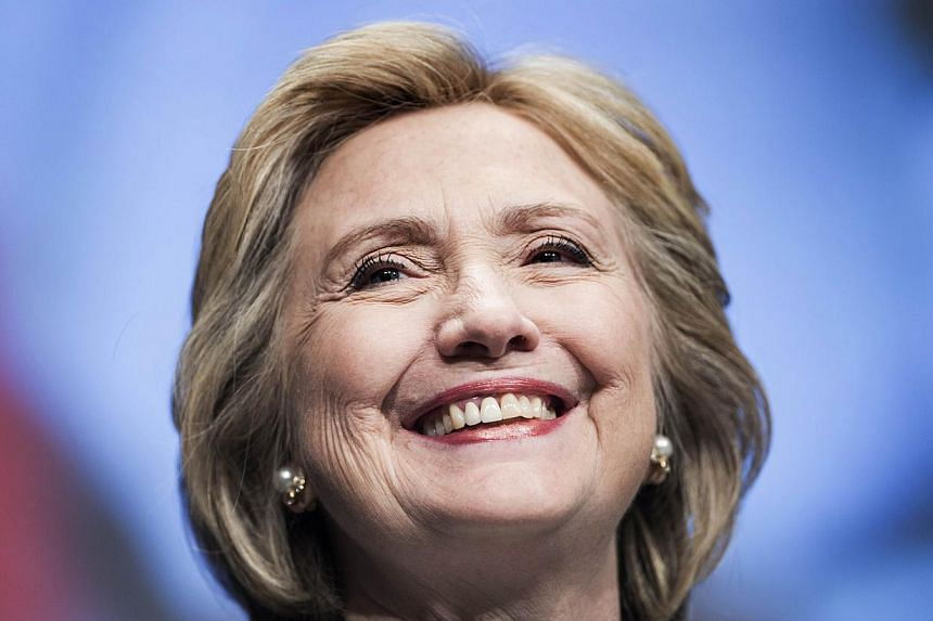 In this May 14, 2014 file photo, Former Secretary of State Hillary Clinton smiles before speaking at the World Bank in Washington, DC. -- PHOTO: AFP