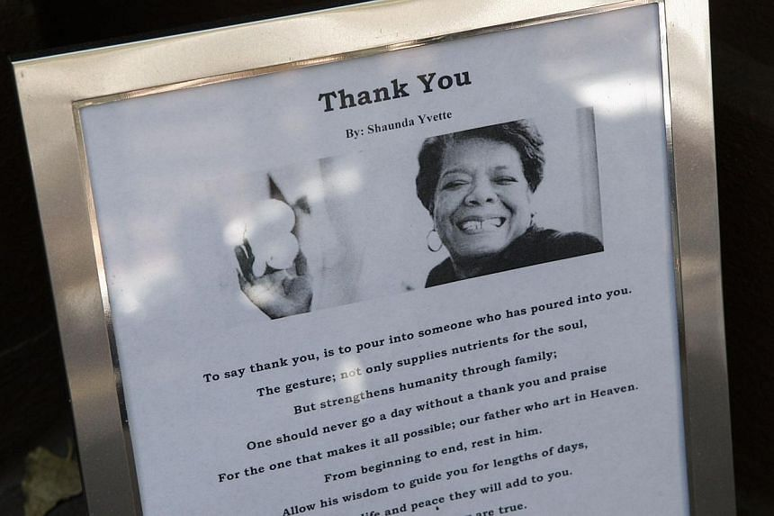 A picture of Dr. Maya Angelou is placed in front of Angelou's home in Harlem in New York Cityon May 31, 2014. -- PHOTO: AFP