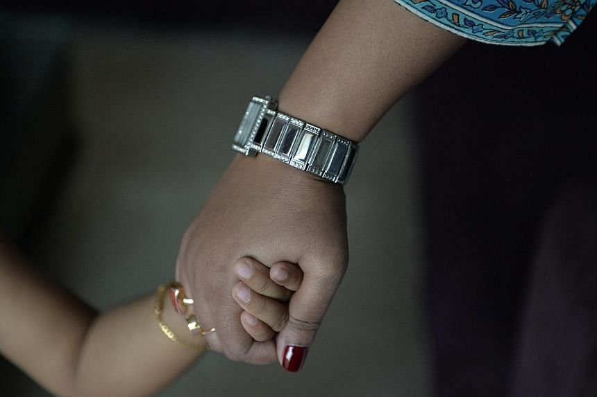 Singapore was removed from Britain's list of countries as the Republic has not signed the Hague Convention on Intercountry Adoption. There is concern that if an adoption is not approved in Britain, the child may get stranded here.