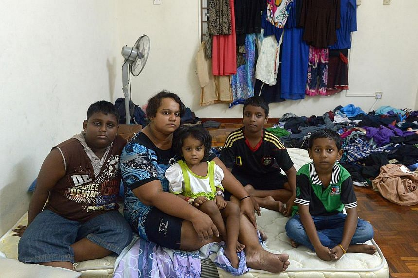 Madam Pusparani Mohan with her children, (top, from left) eldest son Sarveswaran, 11, daughter Thurgashini, two, and sons Dharmaa, 10, and Mageswaran, seven. When news broke of her husband being killed in a freak accident at the Budget Terminal in Ma
