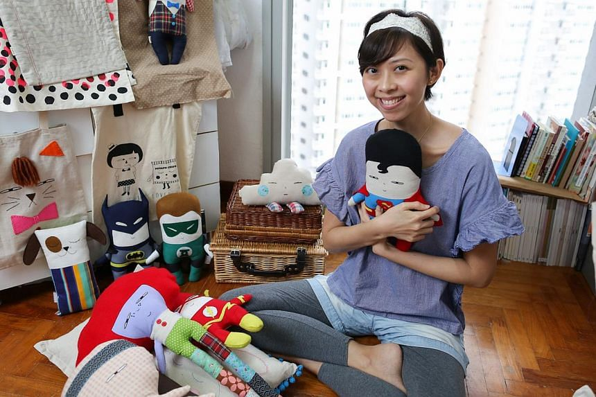 A series of superhero plush toys (above) she recently exhibited in Japan sold for $230 each. -- ST PHOTO: ONG WEE JIN
