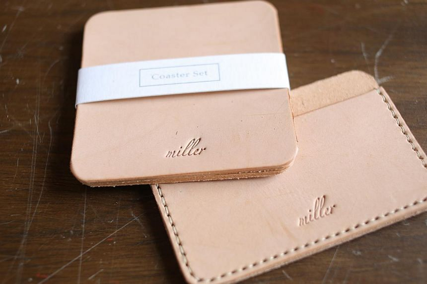 Miller Goods, formed in 2012, features a small selection of leather accessories (above) such as card holders and phone cases he cuts and hand-sews. -- ST PHOTO: ONG WEE JIN