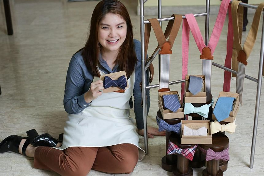 After two years running menswear accessories brand Oldman Handmade, which specialises in brightly coloured and patterned bow ties, suspenders and ties, designer Maureen Koh, 24, is considering closing shop as her costs are too high. -- ST PHOTO: ONG