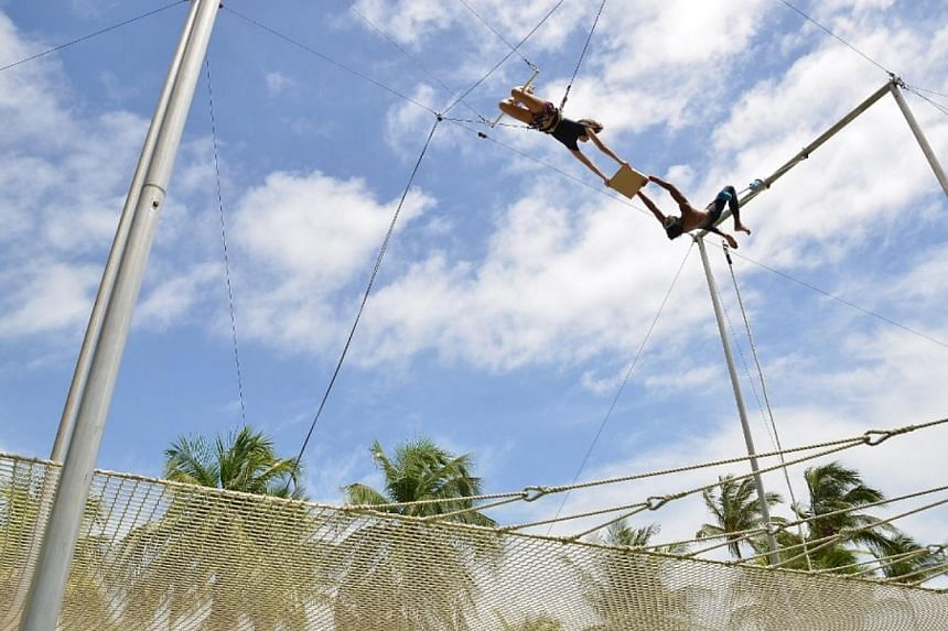 Flying Trapeze Pizza Delivery at Sentosa's State of FUN event on Saturday, June 7, 2014. -- PHOTO: SENTOSA ISLAND