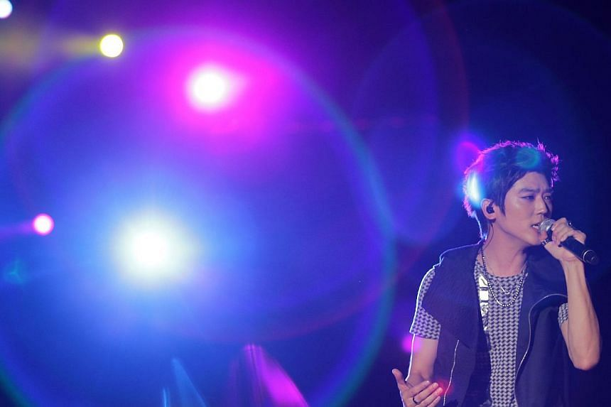 Rising star Bii performs during the Spring Wave music festival 2014 held at Gardens by the Bay on Jun 7, 2014. -- ST PHOTO: NEO XIAOBIN