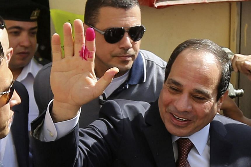 Egypt's new president and former army chief Abdel Fattah al-Sisi gestures after casting his ballot in Cairo, May 26, 2014. -- PHOTO: AFP