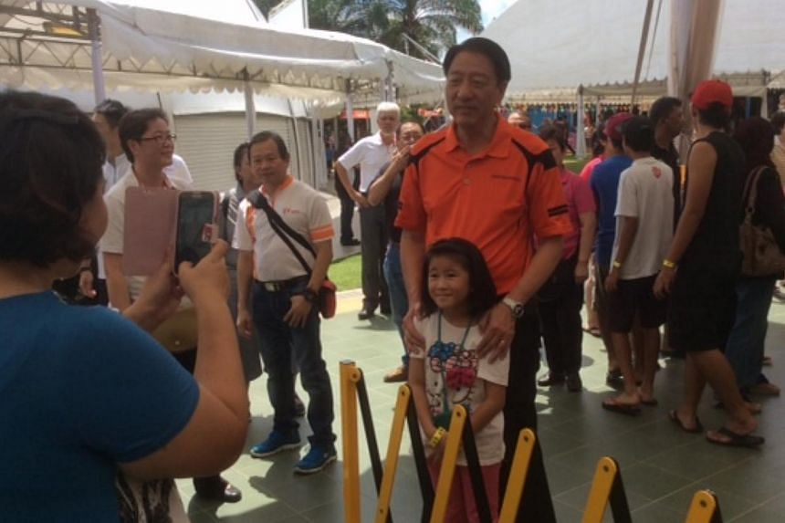 The carnival was attended by Deputy Prime Minister and Home Affairs Minister Teo Chee Hean, who is the anchor minister for Pasir Ris Punggol GRC. -- ST PHOTO: TOH YONG CHUAN