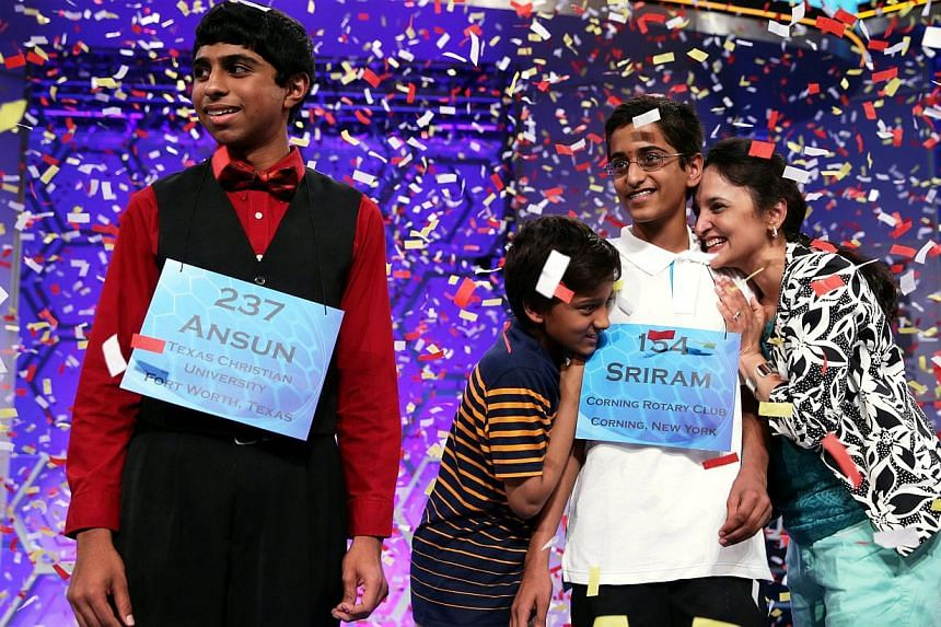 Sriram Hathwar (R) of Painted Post, New York is greeted by family members after he and Ansun Sujoe (L) of Fort Worth, Texas both won the 2014 Scripps National Spelling Bee competition May 29, 2014 in National Harbor, Maryland. Hathwar and Sujoe - bot