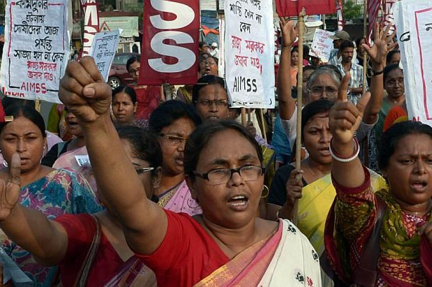 Indian activists from the Social Unity Center of India (SUCI) shout slogans against the state government in protest against the gang-rape and murder of two girls in the district of Badaun in the northern state of Uttar Pradesh and recent rapes in the
