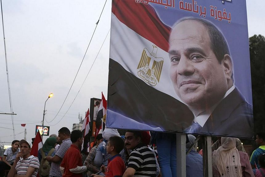 Egyptians celebrate after the swearing-in ceremony of President elect Abdel Fattah al-Sissi, in front of the Presidential Palace in Cairo on June 8, 2014.Egyptian police have arrested seven men accused of sexually assaulting women at celebratio