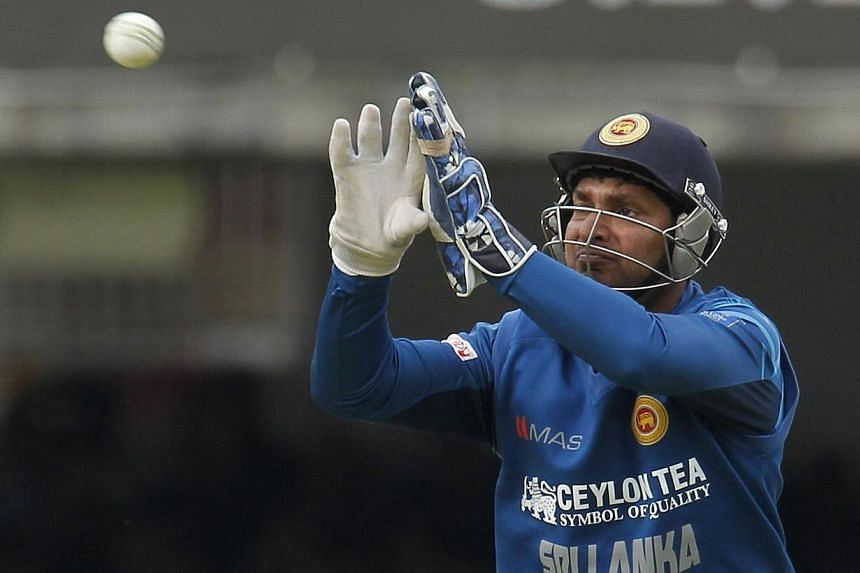 Sri Lankan wicketkeeper Kumar Sangakkara moves in for the ball during the fourth One-Day International (ODI) cricket match between England and Sri Lanka at Lord's cricket ground in London on May 31, 2014. Sri Lanka great Kumar Sangakkara has sai