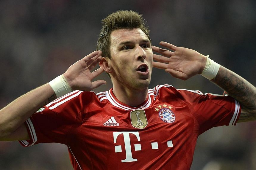Bayern Munich's Croatian striker Mario Mandzukic celebrates scoring the 4-1 goal during the German Cup (DFB Pokal) semi-final football match Bayern Munich vs 1 FC Kaiserslautern in Munich Southern Germany on April 16, 2014. Croatia's World Cup s