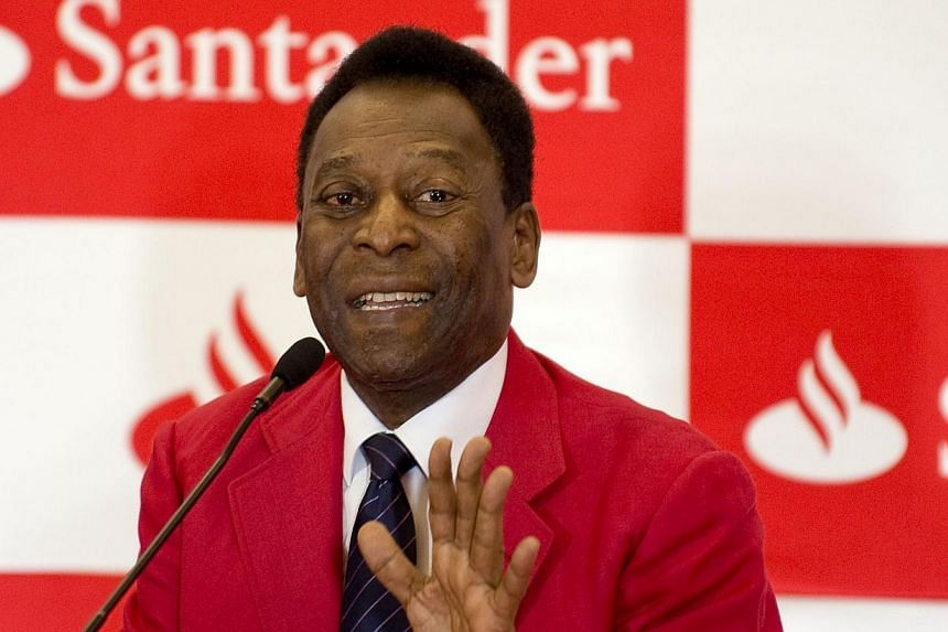 """Brazilian former football star Edson Arantes do Nascimento, aka """"Pele"""", speaks during a press conference about the Banco Santander scholarships at the Universidad Anahuac in Huixquilucan, State of Mexico, Mexico on May 19, 2014.Brazil avenging"""