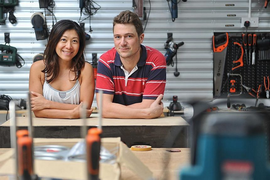"""German carpenter Till Oliver Kautz, 30, and his girlfriend, Ms Fiona Wong, 37, at Home-Fix DIY's """"maker space"""", located at its Tai Seng headquarters. -- ST PHOTO: MATTHIAS HO"""