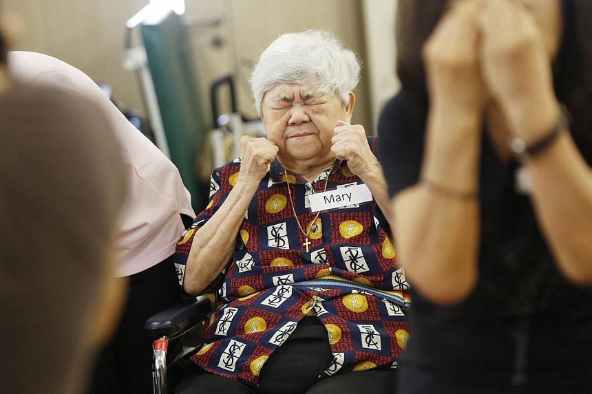 Madam Mary Tan (left), 80, and other residents at the Villa Francis Home for the Aged taking part in dance therapy sessions led by trainers from the Arts Fission Company (right) under an AIC pilot project.