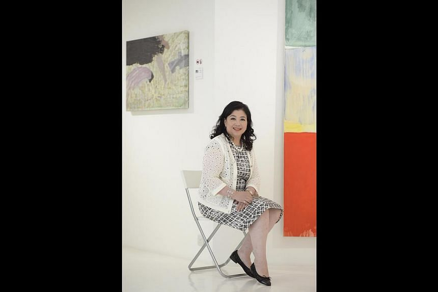 "Gallerist Helina Chan exhibits artists whose works are original and are ""more difficult than decorative"". -- ST PHOTO: DESMOND LIM"
