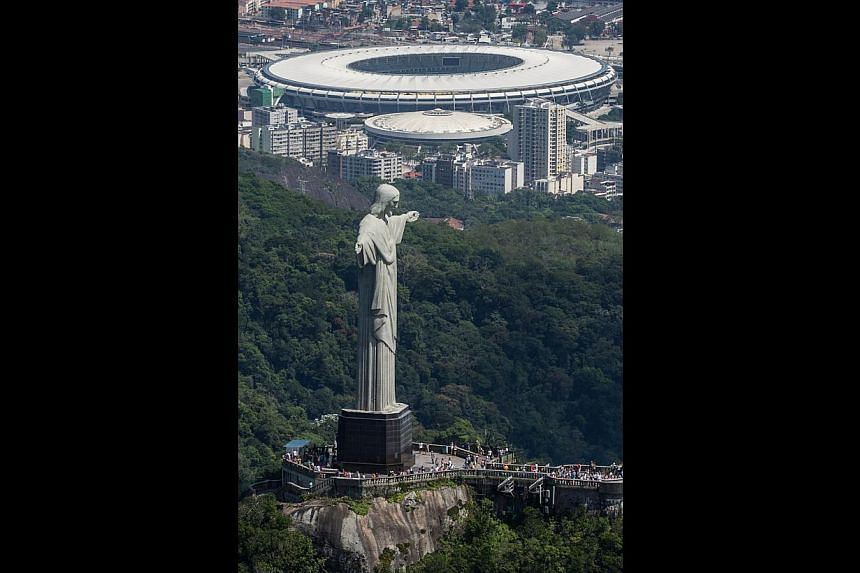 The Christ the Redeemer statue overlooking Rio's Maracana Stadium, where the 2014 World Cup final will be played.