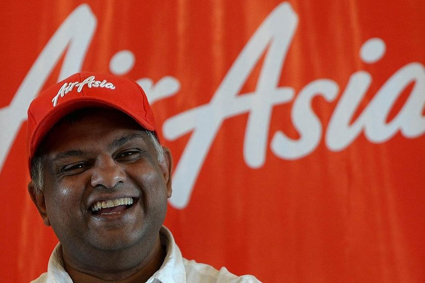 In this photograph taken on July 1, 2013, AirAsia's chief executive Tony Fernandes laughs during a press conference in Mumbai. Asia's biggest budget carrier AirAsia is set to make its maiden Indian flight this week, fuelling a cut-throat fare war in