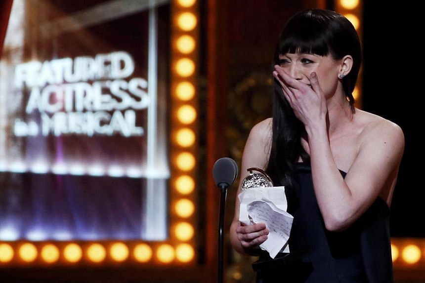 Actress Lena Hall accepts the Award for Best Performance by an Actress in a Feature Role in a Musical for Hedwig And The Angry Inch during the American Theatre Wing's 68th annual Tony Awards at Radio City Music Hall in New York, on June 8, 2014. -- P