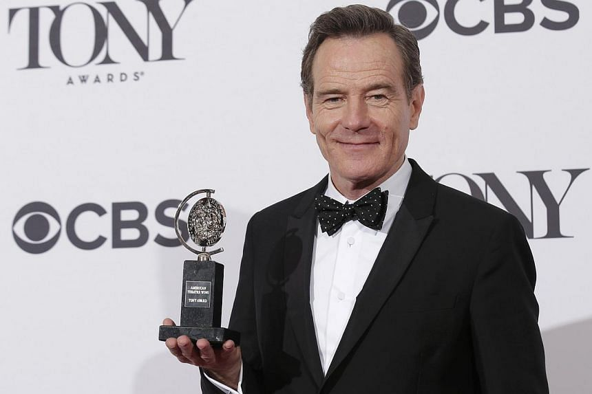 Actor Bryan Cranston poses backstage with his Tony Award for best performance by an actor in a leading role in a play for All The Way at the American Theatre Wing's 68th annual Tony Awards at Radio City Music Hall in New York, on June 8, 2014. -- PHO
