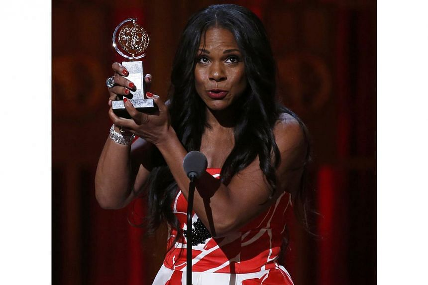 Audra McDonald accepts the award for Best Performance by an Actress in a Leading Role in a Play for Lady Day At Emerson's Bar & Grill during the American Theatre Wing's 68th annual Tony Awards at Radio City Music Hall in New York, on June 8, 2014