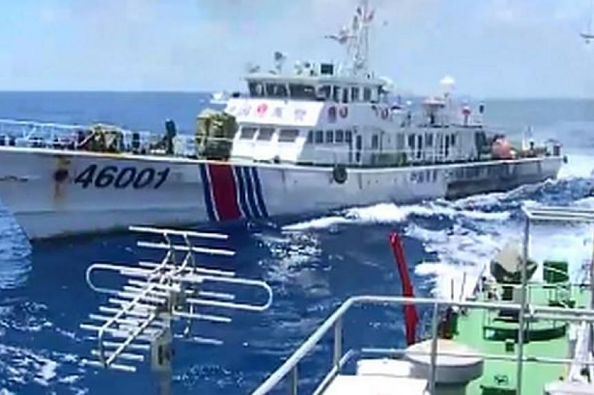 This video grab image taken on June 1, 2014 from Vietnam Coast Guard ship 2016 and released on June 5, 2014 shows the Chinese Coast Guard ship 46001 (L) chasing a Vietnamese vessel near to the site of the Chinese oil rig in the disputed waters in the
