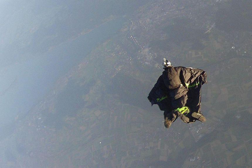 Remo Lang freefalling in a wingsuit above Aarberg on June 8, 2014. -- PHOTO: AFP PHOTO/FERRIS BUEHLER COMMUNICATIONS