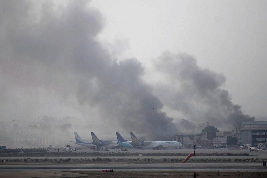 Smoke rises after militants launched an early morning assault at Jinnah International Airport in Karachi on June 9, 2014. Pakistan's security forces said on June 9 they have relaunched a military operation at Karachi airport as gunfire resumed severa