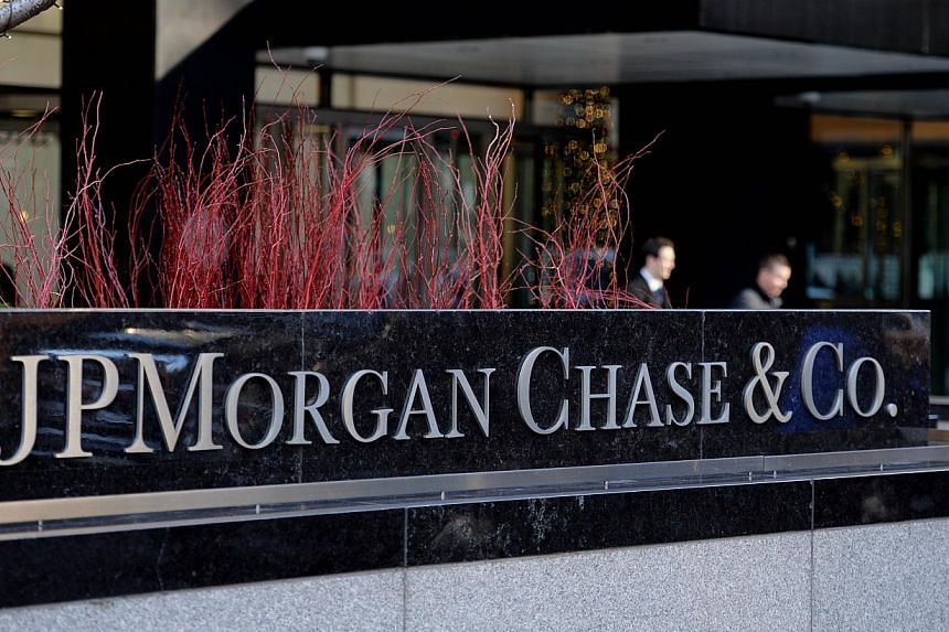 This Dec 12, 2013 file photo shows the headquarters of JP Morgan Chase on Park Avenue in New York. JPMorgan Chase & Co's top mergers and acquisition banker for Asia outside Japan, Rob Sivitilli, will leave the firm for personal reasons, a source