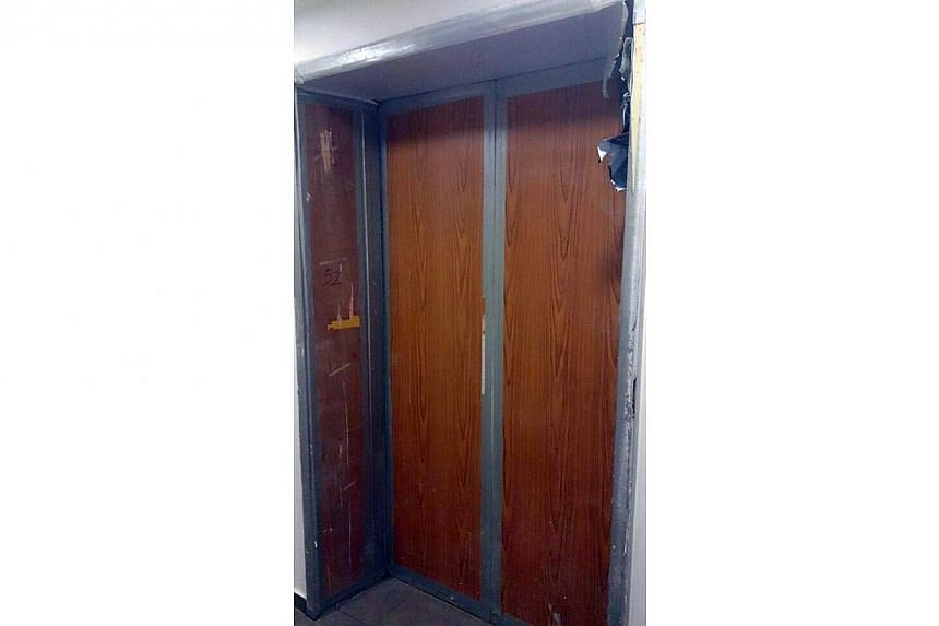 The doors of the service lift at Marina Bay Suites condominium. -- PHOTO: WANBAO