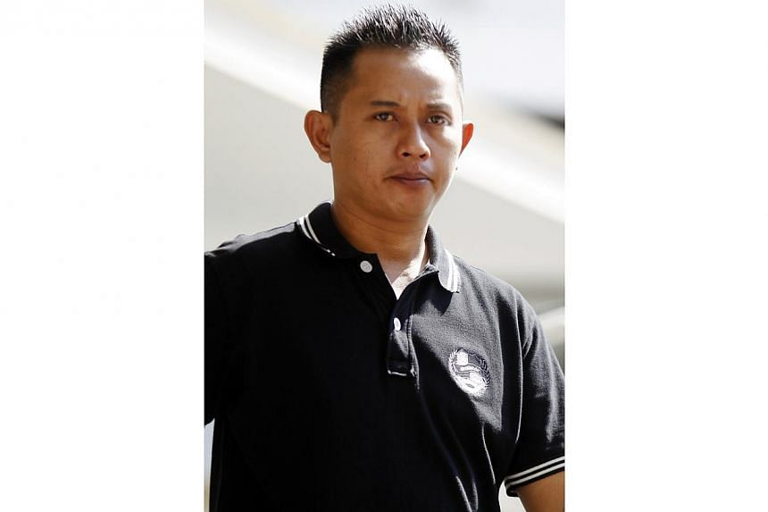 Mohamad Noor Ali, 42, now a logistics assistant, admitted to engaging in commercial sex after he paid a 17-year-old Vietnamese girl $100 for her services at Golden Star Hotel in Lorong 8 Geylang on Oct 28 last year. -- ST PHOTO: WONG KWAI CHOW