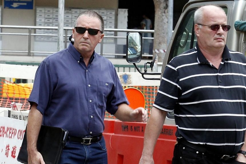 Two British bankers,Timothy Nicholas Goldring (left) and John Andrew Nordmanwere jailed for a total of 15 years on Monday, June 09, 2014, over a bonds scam in which investors lost more than $3 million. -- ST PHOTO:WONG KWAI CHOW