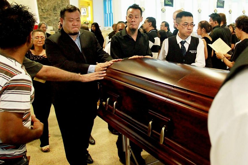 Over 100 family, friends and former colleagues of late entertainment icon Victor Khoo attended his funeral mass at Church of St. Bernadette on Monday afternoon. -- ST PHOTO:LAU FOOK KONG