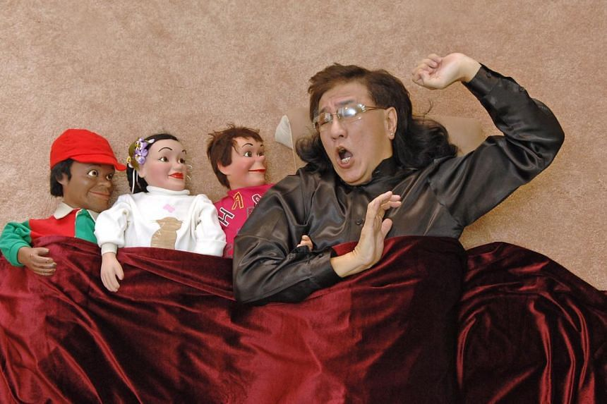 Victor Khoo talks to his puppets (from left) Char Cole, Cha Cha and Charlee before every big show. -- PHOTO: ST FILE