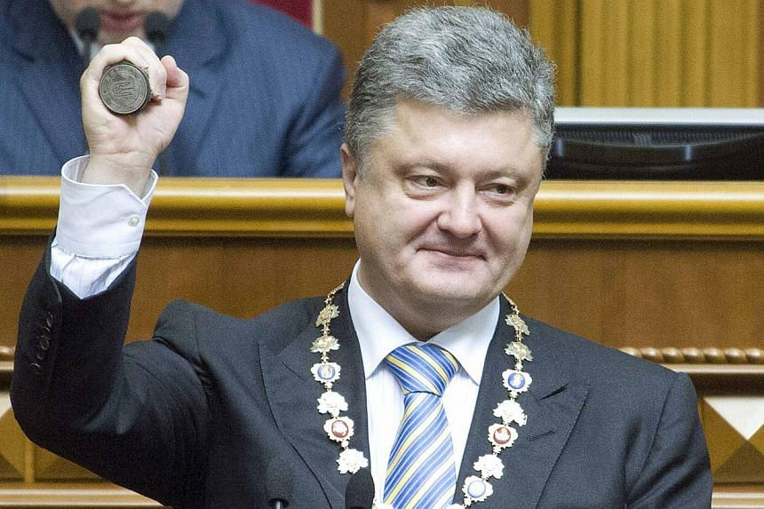 Ukraine's President-elect Petro Poroshenko shows the presidential seal during his inauguration ceremony in the parliament hall in Kiev on June 7, 2014. -- PHOTO: REUTERS