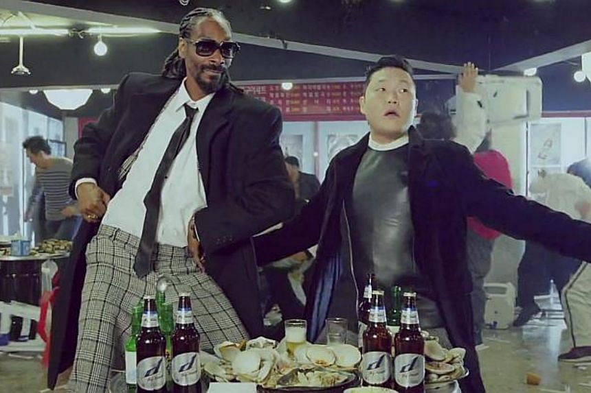 Psy, who set off a global sensation with Gangnam Style, tried out a fresh sound on Sunday as he released a hip-hop tale of drunken debauchery co-starring rap legend Snoop Dogg. -- PHOTO: SCREEN CAPTURE FROM VIDEO
