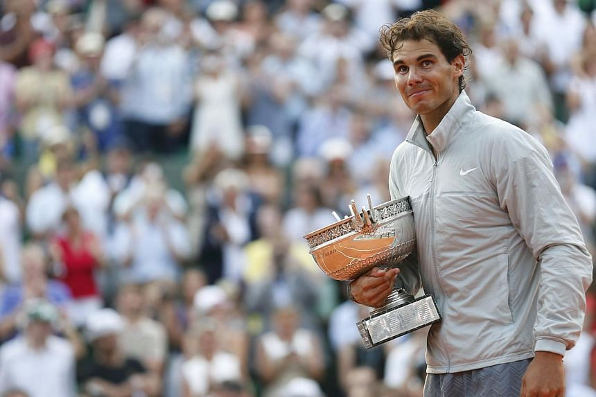 Rafael Nadal of Spain attends the trophy ceremony after defeating Novak Djokovic of Serbia during their men's singles final match to win the French Open Tennis tournament at the Roland Garros stadium in Paris on June 8, 2014. -- PHOTO: REUTERS