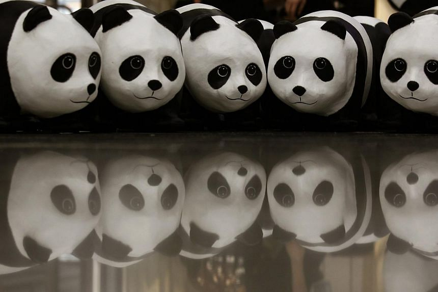 Papier-mache pandas, created by French artist Paulo Grangeon, are seen displayed at the arrival hall of the Hong Kong airport on June 9, 2014.-- PHOTO: REUTERS
