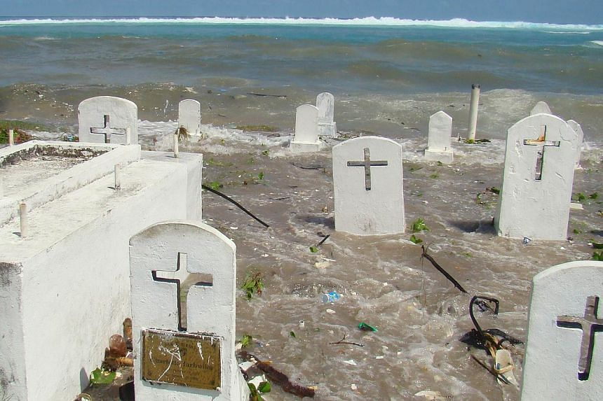 This file photo taken in Dec, 2008, shows a cemetery on the shoreline in Majuro Atoll being flooded from high tides and ocean surges.The skeletal remains of what are believed to be Japanese soldiers have been exposed on a remote Pacific island