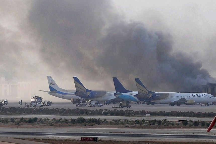 Smoke rises after militants launched an early morning assault at Jinnah International Airport in Karachi on June 9, 2014. Their backpacks stuffed with food and ammunition, a squad of highly trained Taleban fighters attacked Pakistan's biggest ai