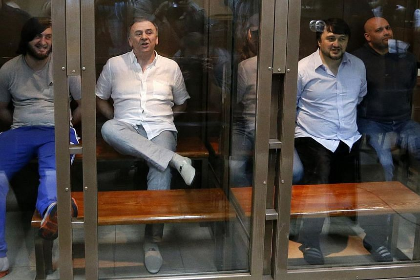 Defendants in the murder trial of Russian journalist and human rights activist Anna Politkovskaya, (from left) Ibragim Makhmoudov, Lom-Ali Gaitukayev, Dzhabrail Makhmoudov, Rustam Makhmoudov and Sergei Khadzhikurbanov attend a court hearing in Moscow