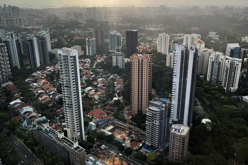 High-rise condominium buildings in the Singapore city centre and outskirts on Feb 1, 2011. Resale prices of completed non-landed private homes in Singapore continued to drop last month, as the number of transactions fell. -- ST PHOTO: FILE
