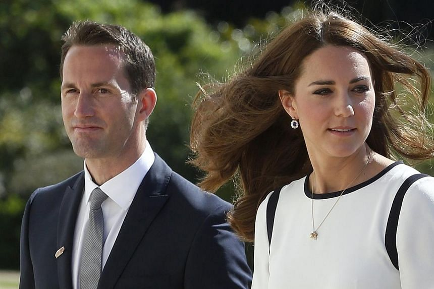 Britain's Catherine, Duchess of Cambridge, is greeted by Olympic sailor Ben Ainslie as she arrives to view an America's Cup boat and to meet supporters of a bid to launch a British Team for the America's Cup, at the National Maritime Museum in London