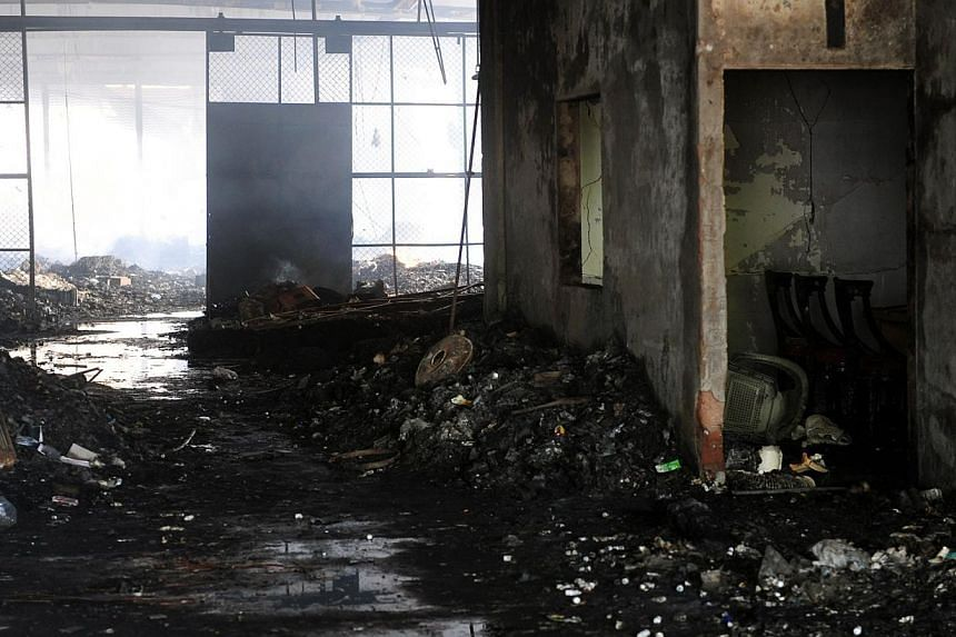 A view of the damaged premises of a cold-storage cargo facility at the Jinnah International Airport in Karachi on June 10, 2014, following the early June 9 attack by militants on the airport.A security academy at Karachi's Airport came under at