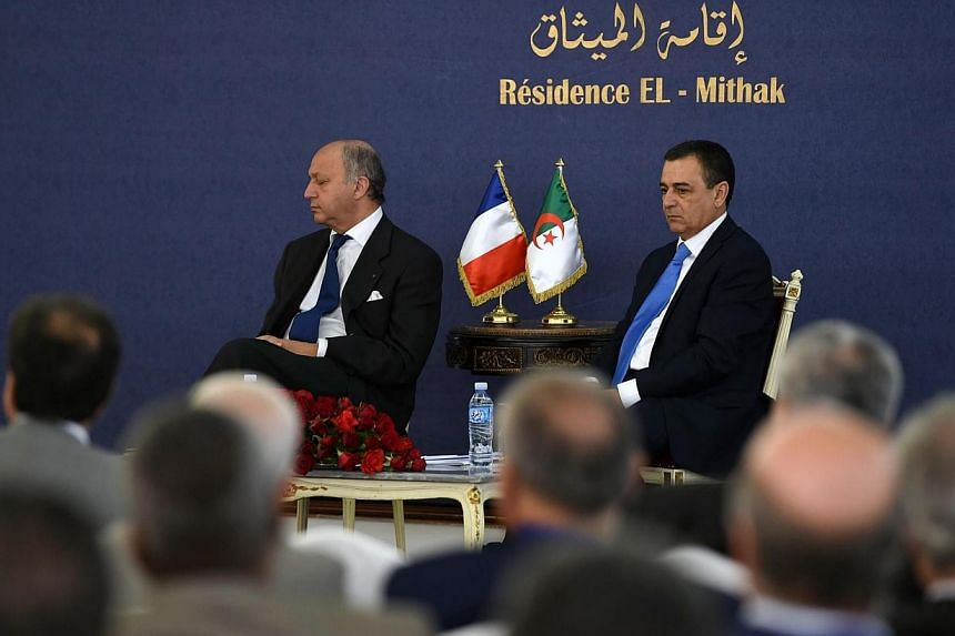 French Foreign Minister Laurent Fabius (left) appears to be sleeping during a conference with Algerian Minister of Industry and Mining, Abdeslam Bouchouareb (right), in the capital Algiers on June 9, 2014.French Foreign Minister Laurent Fabius