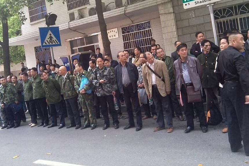 This undated mobile phone picture shows former soldiers participating in a protest outside the provincial government building in Changsha, central China's Hunan province.Marginalised and misunderstood, Chinese Vietnam veterans - who fought in a